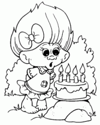 A small Troll blows on its four candles